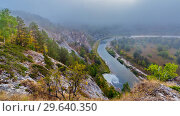 Купить «Top view of the rocky shore of the river on a foggy morning. The nature of the Urals.», фото № 29640350, снято 7 сентября 2018 г. (c) Акиньшин Владимир / Фотобанк Лори