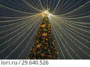 Moscow, Russia -January 2. 2019. Beautiful spruce on Lubyanka Square during festival Journey to Christmas. Decoration with logo Promsvyazbank. Редакционное фото, фотограф Володина Ольга / Фотобанк Лори