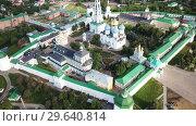 Купить «View from drones of churches in Trinity Lavra of St. Sergius Monastery, Sergiyev Posad», видеоролик № 29640814, снято 28 июня 2018 г. (c) Яков Филимонов / Фотобанк Лори