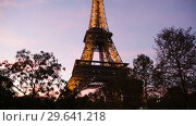 Купить «View of majestic illuminated Eiffel Tower in Paris at twilight, France», видеоролик № 29641218, снято 9 октября 2018 г. (c) Яков Филимонов / Фотобанк Лори