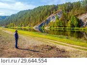 Купить «Tourist admires the picturesque view of the rocky shore of the river. The nature of the Urals.», фото № 29644554, снято 7 сентября 2018 г. (c) Акиньшин Владимир / Фотобанк Лори
