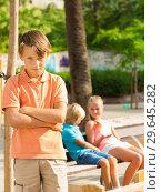 Купить «Portrait of boy 8-11 years old which is taking offense on his friends», фото № 29645282, снято 8 июля 2017 г. (c) Яков Филимонов / Фотобанк Лори
