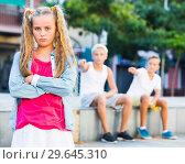 Купить «Offended girl after quarrel with friends», фото № 29645310, снято 27 июля 2017 г. (c) Яков Филимонов / Фотобанк Лори