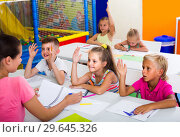 Купить «children sitting together and studying in class at school», фото № 29645326, снято 12 ноября 2019 г. (c) Яков Филимонов / Фотобанк Лори