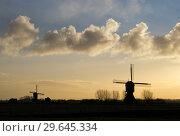 Купить «Windmill the Zandwijkse windmolen», фото № 29645334, снято 2 марта 2007 г. (c) John Stuij / Фотобанк Лори