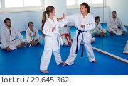 Купить «Girls training during karate class», фото № 29645362, снято 25 марта 2017 г. (c) Яков Филимонов / Фотобанк Лори