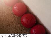 Купить «Row of red heavy balls in the corner of the room», фото № 29645770, снято 3 ноября 2018 г. (c) Pavel Biryukov / Фотобанк Лори