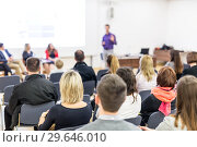 Купить «Audience in lecture hall participating at business conference.», фото № 29646010, снято 15 января 2019 г. (c) Matej Kastelic / Фотобанк Лори