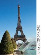 Купить «Eiffel Tower on blue sky background», фото № 29647242, снято 10 октября 2018 г. (c) Яков Филимонов / Фотобанк Лори