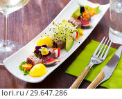 Купить «Tasty fried tuna with mango and avocado, served with fig and flower», фото № 29647286, снято 14 октября 2019 г. (c) Яков Филимонов / Фотобанк Лори