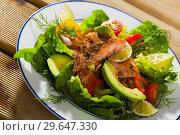 Купить «Salad with fried trout, avocado, tomatoes», фото № 29647330, снято 18 февраля 2019 г. (c) Яков Филимонов / Фотобанк Лори