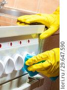 Купить «cleaning the kitchen - cleaning the stove, hands with a rag close-up», фото № 29647590, снято 9 июля 2016 г. (c) Константин Лабунский / Фотобанк Лори