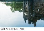 Купить «Reflection in the pond of the turrets  of the 14th century Chateau de Trecesson», фото № 29647718, снято 18 сентября 2017 г. (c) Николай Коржов / Фотобанк Лори