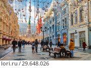 Купить «Nikolskaya street decorated in New year and Christmas holidays and tourists walking on it, Moscow, Russia», фото № 29648026, снято 29 декабря 2018 г. (c) Наталья Волкова / Фотобанк Лори