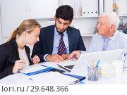 Купить «Employees are writing financial reports», фото № 29648366, снято 27 июня 2017 г. (c) Яков Филимонов / Фотобанк Лори