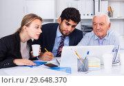 Купить «Managers are writing financial reports», фото № 29648370, снято 27 июня 2017 г. (c) Яков Филимонов / Фотобанк Лори