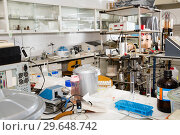 Купить «Interior of chemical laboratory equipped with different tools», фото № 29648742, снято 19 января 2019 г. (c) Яков Филимонов / Фотобанк Лори