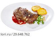 Купить «Well done fried beef loin with tomato sauce and pine nuts», фото № 29648762, снято 26 мая 2019 г. (c) Яков Филимонов / Фотобанк Лори