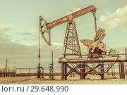 Купить «Pump jack. Extraction of oil. Petroleum concept.», фото № 29648990, снято 3 июня 2016 г. (c) bashta / Фотобанк Лори