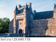Купить «The turrets and drawbridge of the 14th century Chateau de Trecesson in the Forest of Paimpont», фото № 29649118, снято 18 сентября 2017 г. (c) Николай Коржов / Фотобанк Лори