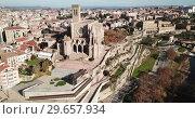 Купить «Aerial view of Manresa town with Basilica de Santa Maria», видеоролик № 29657934, снято 9 декабря 2018 г. (c) Яков Филимонов / Фотобанк Лори