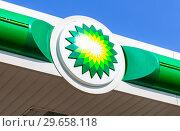 Купить «BP - British Petroleum petrol station logo over blue sky», фото № 29658118, снято 17 августа 2017 г. (c) FotograFF / Фотобанк Лори