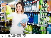 Купить «happy girl customer looking for cleaners for home in supermarket», фото № 29658754, снято 23 ноября 2016 г. (c) Яков Филимонов / Фотобанк Лори