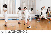 Купить «Mixed age group of athletes at fencing exercise», фото № 29659042, снято 30 мая 2018 г. (c) Яков Филимонов / Фотобанк Лори