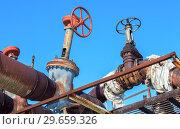 Купить «Old rusty pipeline with valves against the blue sky background», фото № 29659326, снято 10 февраля 2018 г. (c) FotograFF / Фотобанк Лори