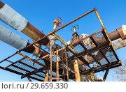 Купить «Old rusty pipeline with valves against the blue sky background», фото № 29659330, снято 10 февраля 2018 г. (c) FotograFF / Фотобанк Лори