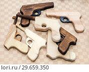 Купить «Different handmade wooden toy pistols for children», фото № 29659350, снято 18 февраля 2018 г. (c) FotograFF / Фотобанк Лори