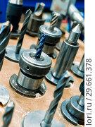 Купить «Metal drills, cutters, cones. Metal cutting tools installed in clamping chucks.», фото № 29661378, снято 27 сентября 2018 г. (c) Андрей Радченко / Фотобанк Лори