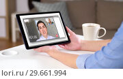 Купить «woman having video call on tablet computer at home», видеоролик № 29661994, снято 21 февраля 2019 г. (c) Syda Productions / Фотобанк Лори