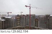 Купить «Aerial view of construction site in winter city», видеоролик № 29662194, снято 25 июля 2018 г. (c) Данил Руденко / Фотобанк Лори