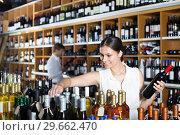 Купить «female customer in wine store», фото № 29662470, снято 16 января 2019 г. (c) Яков Филимонов / Фотобанк Лори