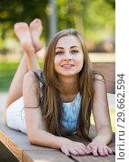 Купить «portrait of smiling adult girl outside in park», фото № 29662594, снято 8 июня 2017 г. (c) Яков Филимонов / Фотобанк Лори