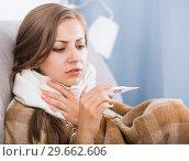 Купить «Sick girl on sofa with thermometer», фото № 29662606, снято 24 июня 2017 г. (c) Яков Филимонов / Фотобанк Лори