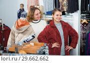 Купить «Women trying coat in clothing boutique», фото № 29662662, снято 6 декабря 2018 г. (c) Яков Филимонов / Фотобанк Лори