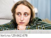 Купить «Portrait of sorrowful woman sitting at home», фото № 29662678, снято 6 ноября 2018 г. (c) Яков Филимонов / Фотобанк Лори
