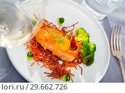 Купить «Fried trout steak with carrot brushwood, broccoli, cucumber, figs», фото № 29662726, снято 23 марта 2019 г. (c) Яков Филимонов / Фотобанк Лори