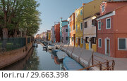 Купить «Waterside street with brightly painted houses and walking people. Burano, Italy», видеоролик № 29663398, снято 17 октября 2019 г. (c) Данил Руденко / Фотобанк Лори
