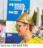 Купить «Russia, Samara, July 2018: a young Swedish fan wearing a helmet with horns at the World Championships.», фото № 29664590, снято 7 июля 2018 г. (c) Акиньшин Владимир / Фотобанк Лори