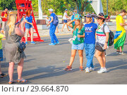 Купить «Russia, Samara, July 2018: Russian and Mexican football fans with national flags together communicate at the World Cup.», фото № 29664870, снято 2 июля 2018 г. (c) Акиньшин Владимир / Фотобанк Лори