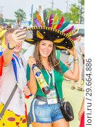 Купить «Russia, Samara, July 2018: beautiful Mexican football fan during the FIFA 2018 World Cup.», фото № 29664886, снято 2 июля 2018 г. (c) Акиньшин Владимир / Фотобанк Лори