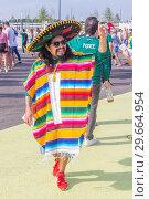 Купить «Russia, Samara, July 2018: beautiful Mexican fans in national clothes before the match Brazil Mexico for the World Cup.», фото № 29664954, снято 2 июля 2018 г. (c) Акиньшин Владимир / Фотобанк Лори