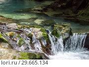 Купить «Водопад на горной реке в Абхазии», фото № 29665134, снято 17 июня 2018 г. (c) Евгений Ткачёв / Фотобанк Лори