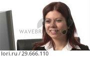 Купить «Stock Footage of Woman on Headset», видеоролик № 29666110, снято 15 февраля 2008 г. (c) Wavebreak Media / Фотобанк Лори