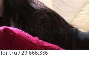 Купить «Woman on Sofa with Laptop», видеоролик № 29666386, снято 26 февраля 2008 г. (c) Wavebreak Media / Фотобанк Лори