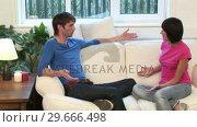 Купить «Young Couple on Sofa Arguing», видеоролик № 29666498, снято 1 марта 2008 г. (c) Wavebreak Media / Фотобанк Лори