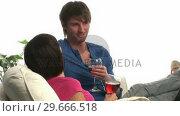 Купить «A Couple Enjoying a Glass of Wine», видеоролик № 29666518, снято 1 марта 2008 г. (c) Wavebreak Media / Фотобанк Лори